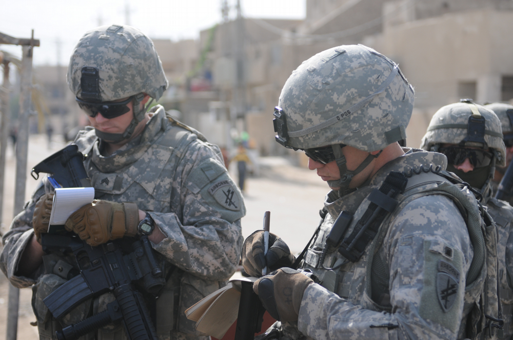 Two Soldiers Taking Notes